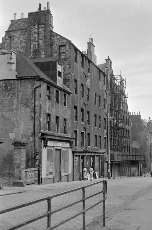 General view of 81-93 Canongate, Golfer's Land, from SW.
