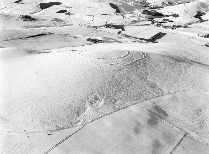Oblique aerial view centred on the remains of the fort at Brown Caterthun, looking to the WNW.