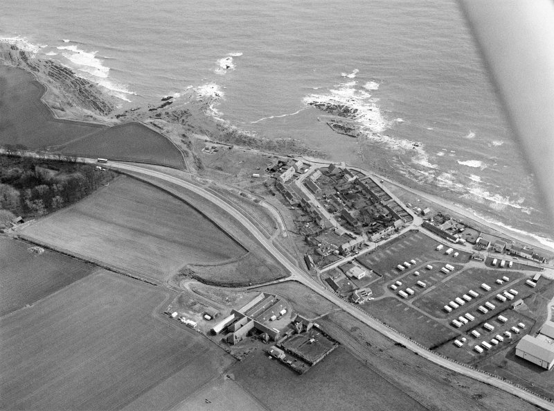 General oblique aerial view centred on the village of Cowie, Stonehaven, looking to the ENE.