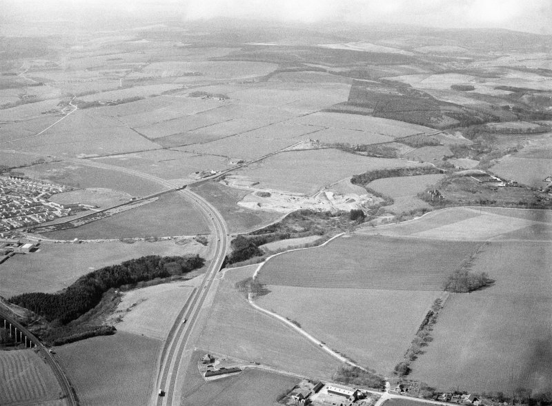 General oblique aerial view centred on Glenury Viaduct, sand and gravel workings and Stonehaven bypass, looking to the W.