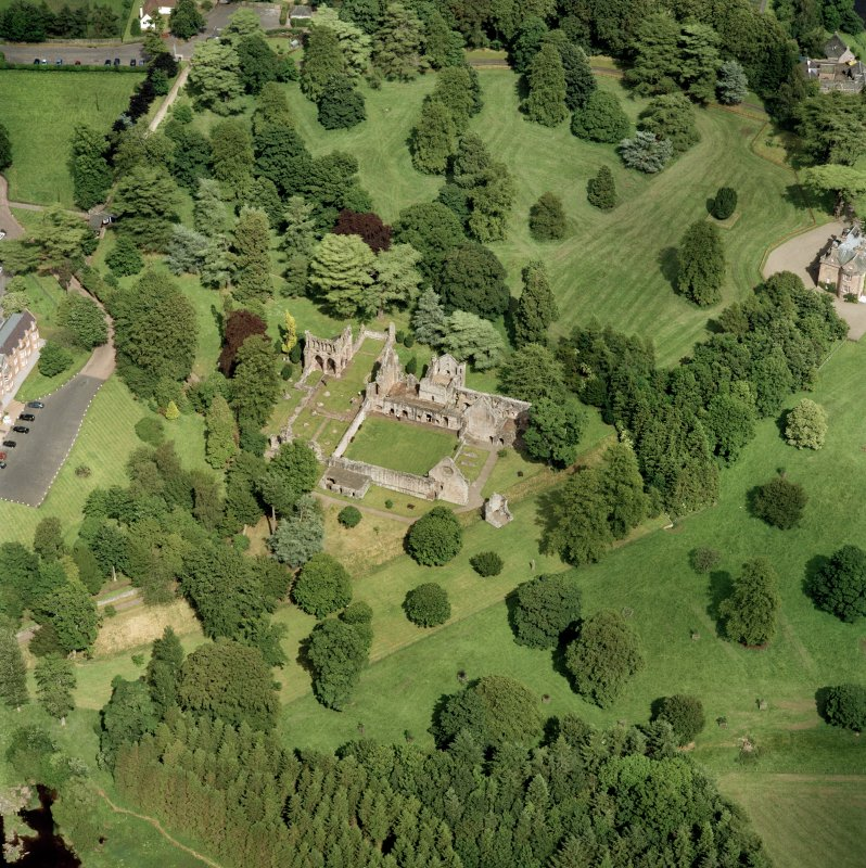 Oblique aerial view, taken from the SW, centred on the abbey.