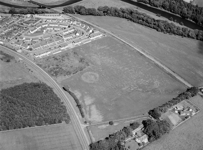 Oblique aerial view centred on the remains of the stone circle and henge at Broomend of Crichie, looking to the NNE.