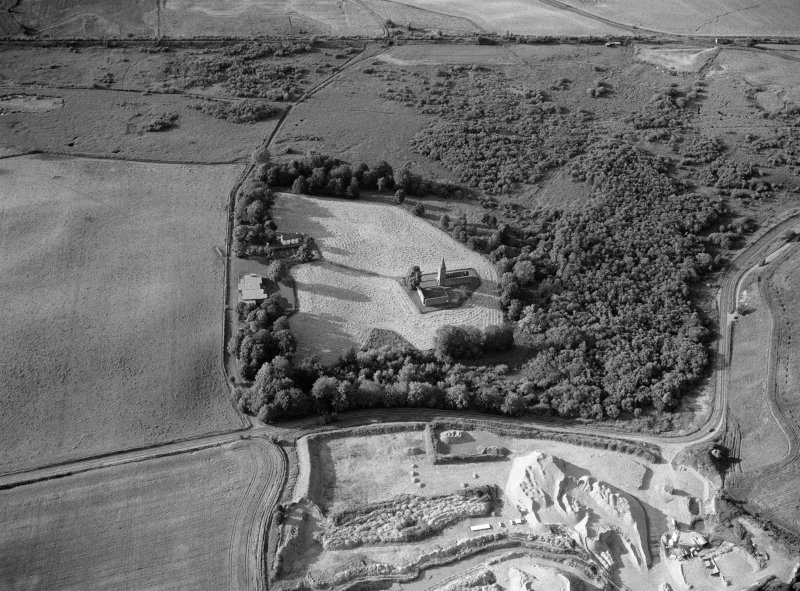 Oblique aerial view centred on the remains of Restenneth Priory  with pits and a possible souterrain adjacent, looking to the N.
