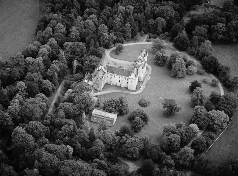 Oblique aerial view centred on Fyvie Castle with the racquets court adjacent, looking to the ENE.