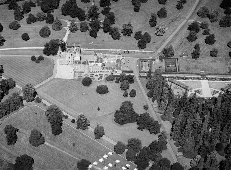 Oblique aerial view centred on Glamis Castle and policies, looking to the NW.