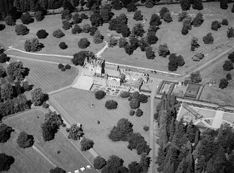 Oblique aerial view centred on Glamis Castle and policies, looking to the NNW.