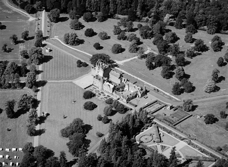 Oblique aerial view centred on Glamis Castle and policies, looking to the WNW.