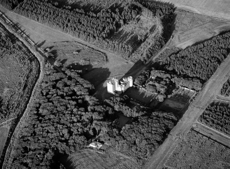 Oblique aerial view centred on Cairnbulg Castle, looking to the ENE.