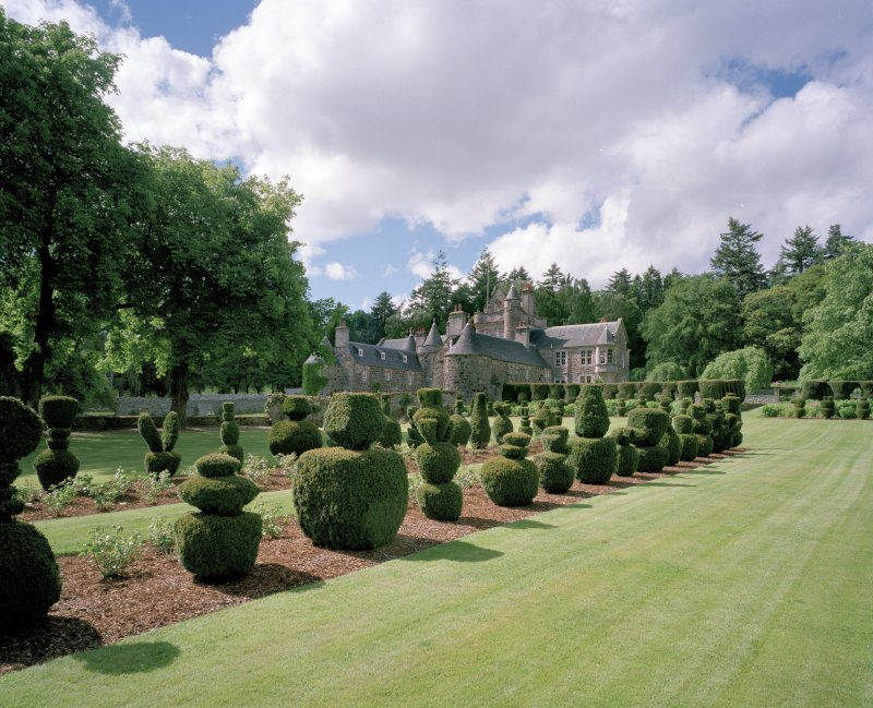 View from SE showing topiary garden with Glenkindie House, Aberdeenshire, behind.