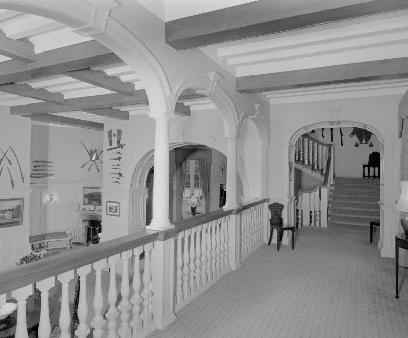 Interior.  View of main hall entrance gallery from E looking towards the principal staircase.