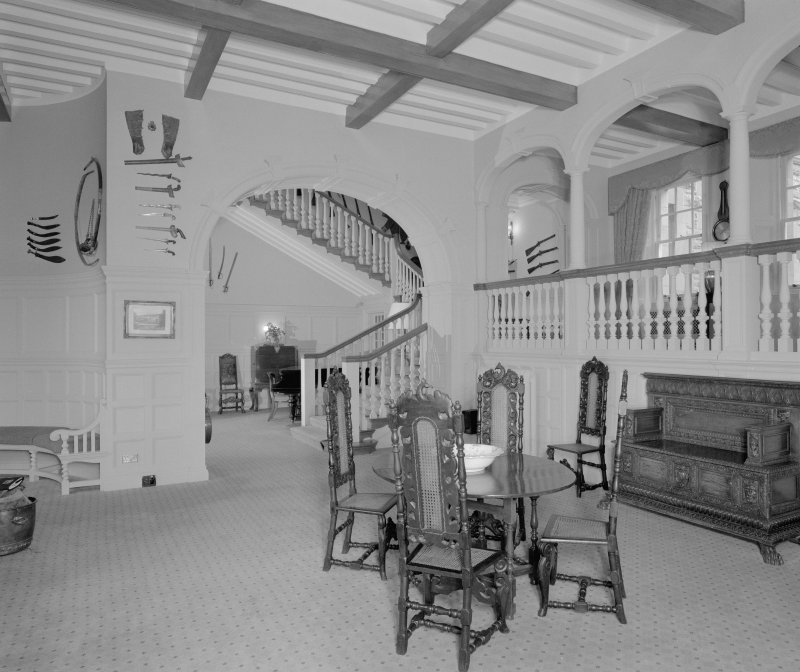 View of main hall in Glenkindie House, Aberdeenshire, showing entrance gallery and principal staircase. Taken from East.