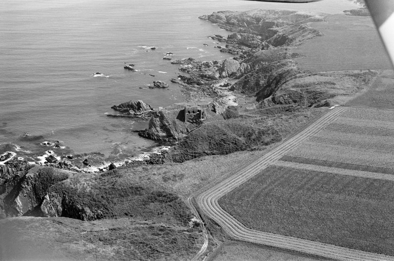 General oblique aerial view of Findlater castle, looking to the ENE.