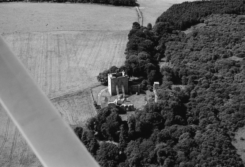 Oblique aerial view centred on the remains of Spynie Palace, looking to the W.