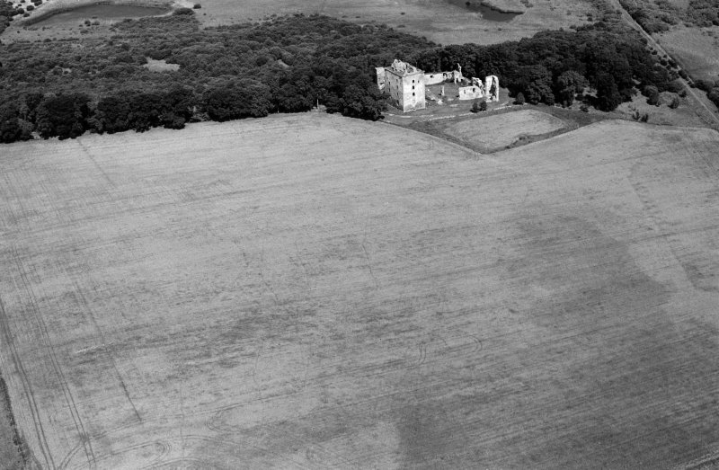 Oblique aerial view centred on the remains of Spynie Palace, looking to the NNE.