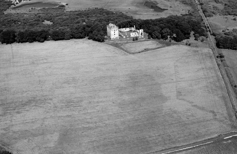 Oblique aerial view centred on the remains of Spynie Palace, looking to the N.
