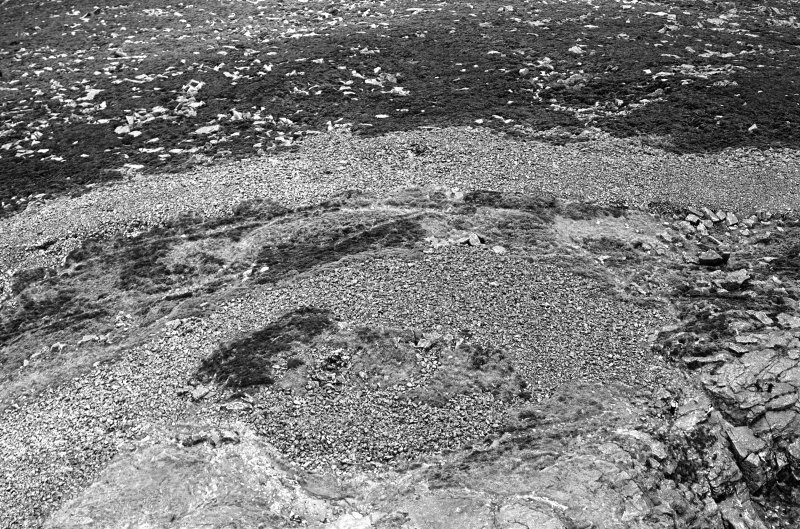 Oblique aerial view centred on the remains of the fort at Mither Tap of Bennachie, looking to the ESE.