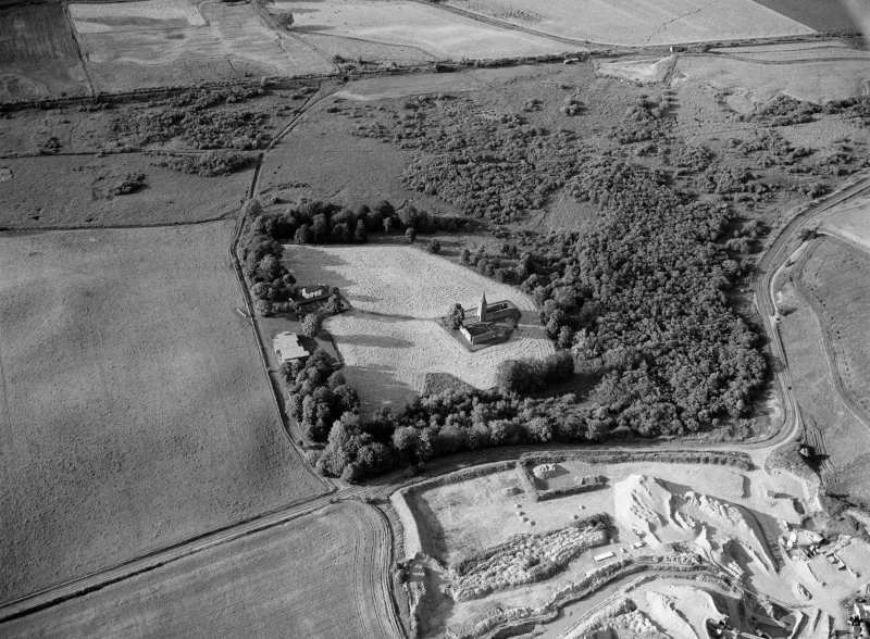 Oblique aerial view centred on the remains of Restenneth Priory with pits and a possible souterrain adjacent, looking to the NE.
