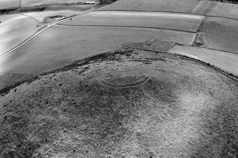 Oblique aerial view centred on the remains of the fort at Wheedlemont, looking to the SE.