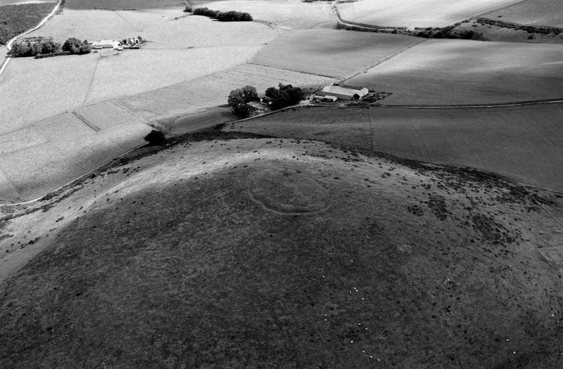 Oblique aerial view centred on the remains of the fort at Wheedlemont, looking to the NE.