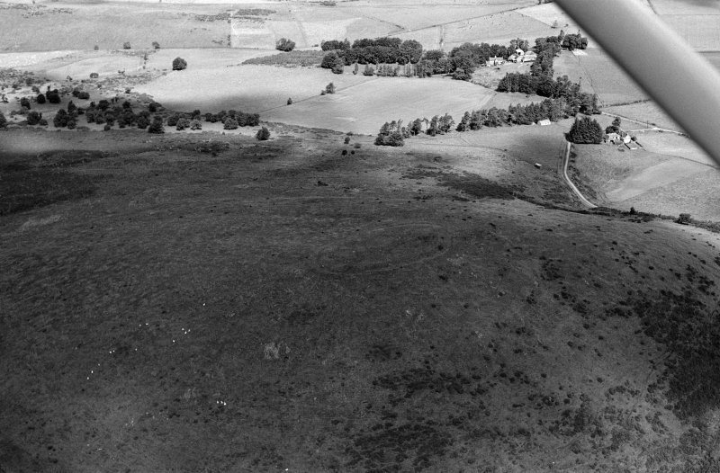 Oblique aerial view centred on the remains of the fort at Wheedlemont, looking to the N.