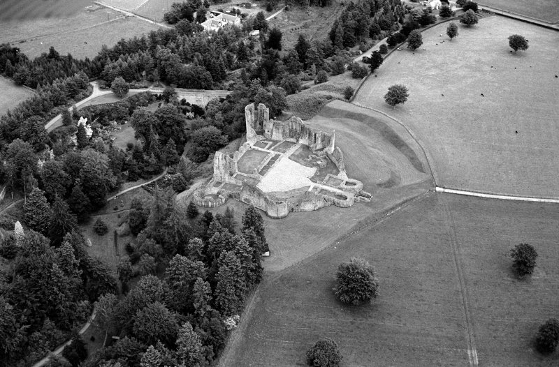 Oblique aerial view centred on the remains of Kildrummy Castle, looking to the NE.