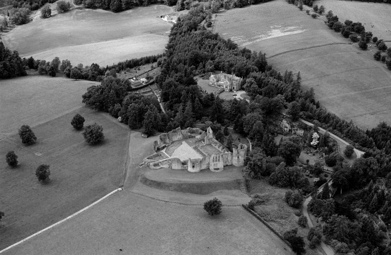 Oblique aerial view centred on the remains of Kildrummy Castle, looking to the SW.