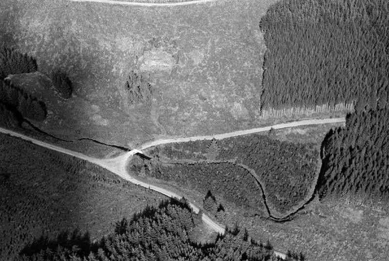 Oblique aerial view centred on the remains of the henge at Wormy Hillock, looking to the NE.