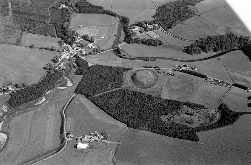 Oblique aerial view centred on the remains of the castle and motte of Doune of Invernochty, looking to the SE.
