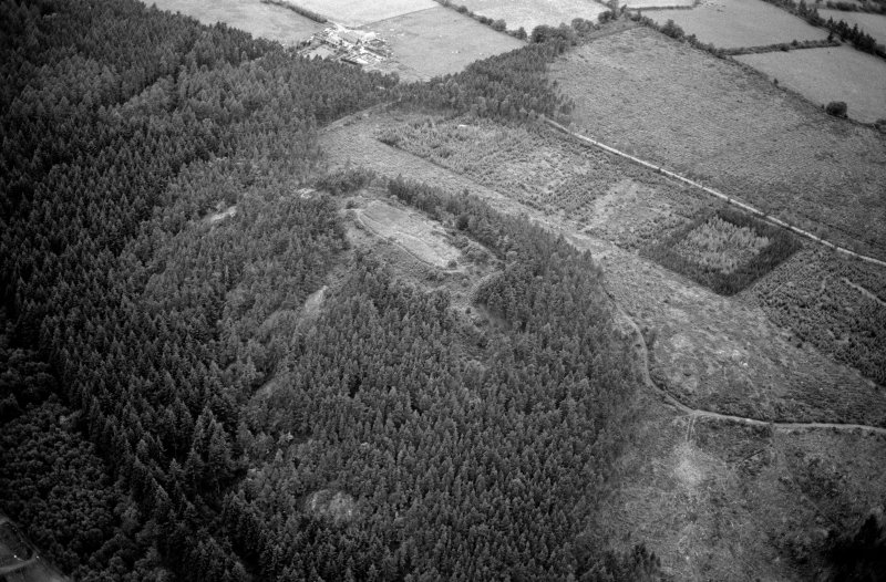 Oblique aerial view centred on the remains of the vitrified fort at Craig Phadrig, looking to the WSW.