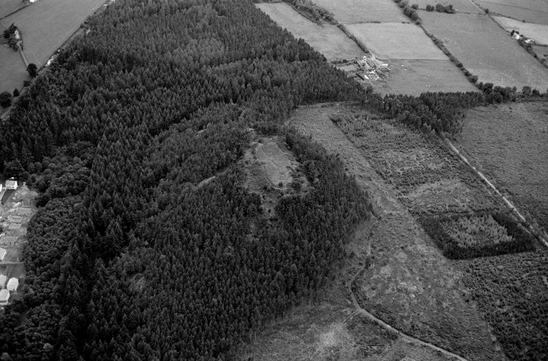Oblique aerial view centred on the remains of the vitrified fort at Craig Phadrig, looking to the SW.