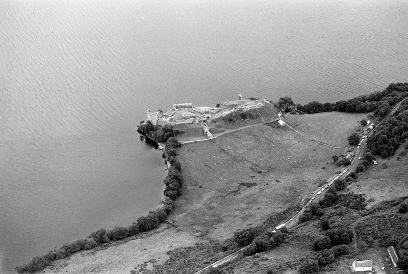 Oblique aerial view centred on Urquhart Castle, looking to the SE.