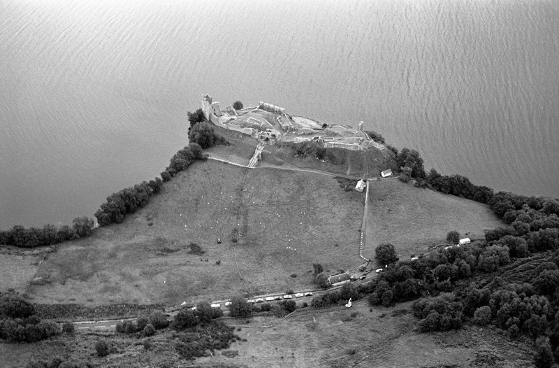 Oblique aerial view centred on Urquhart Castle, looking to the E.