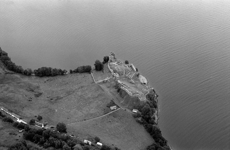 Oblique aerial view centred on Urquhart Castle, looking to the ENE.