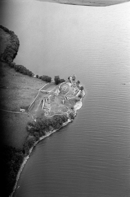 Oblique aerial view centred on Urquhart Castle, looking to the N.