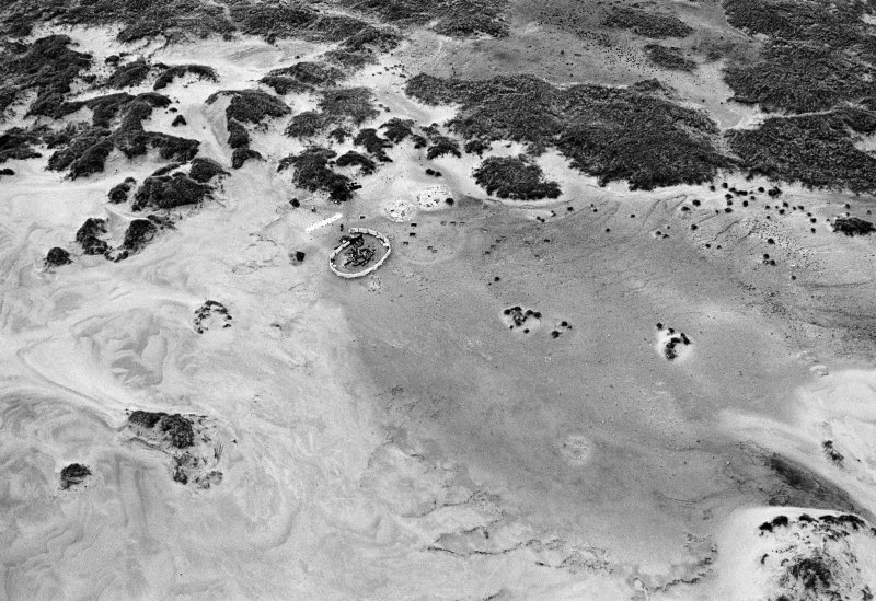 Oblique aerial view centred on the remains of hut circles and the midden at Sands of Forvie.
