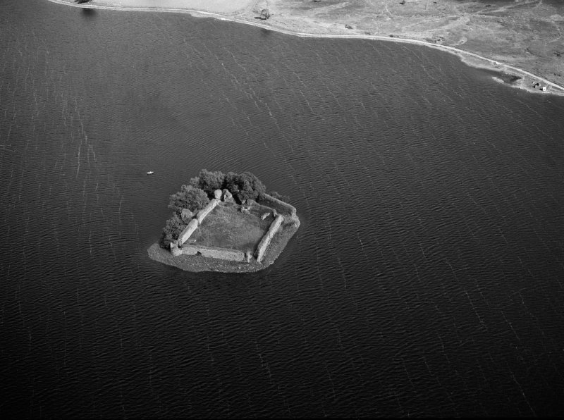 Oblique aerial view centred on the remains of Lochindorb Castle, looking to the ENE.