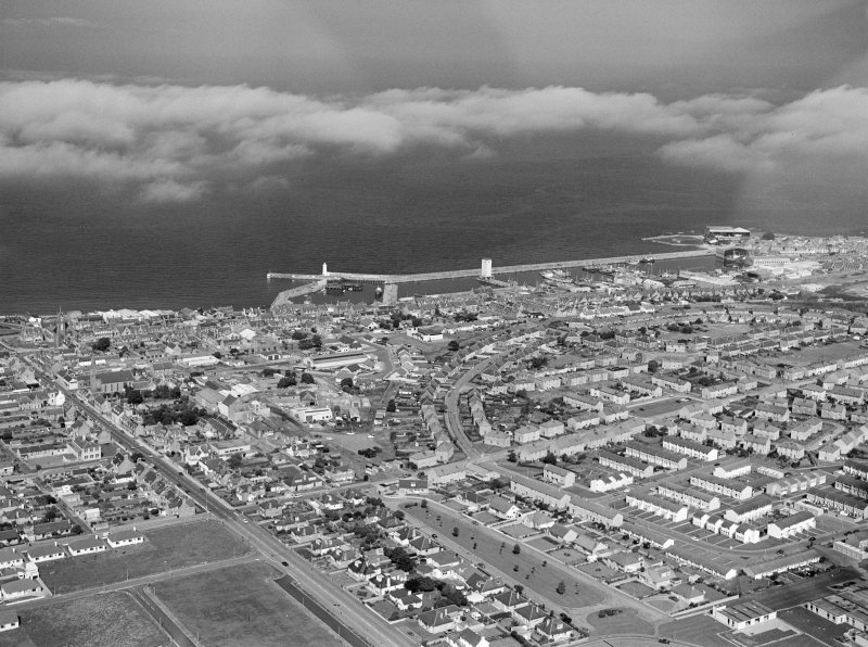 Oblique aerial view centred on the harbour and town of Buckie, looking to the NNE.
