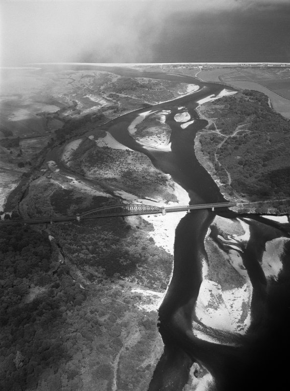 Oblique aerial view of the mouth of the River Spey centred on the Spey viaduct with the Garmouth and Kingston Golf Course adjacent, looking to the NNW.