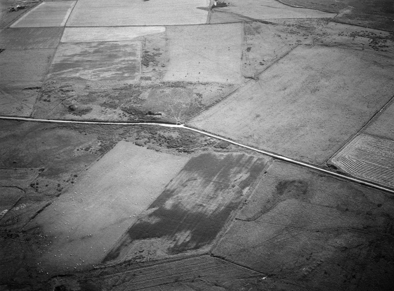 Oblique aerial view centred on the remains of the stone rows at the Hill O' Many Stanes, Clyth with cropmarks adjacent, looking to the SW.