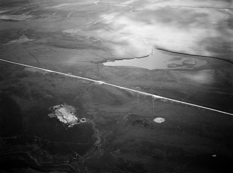 Oblique aerial view centred on the excavation of the long cairn at Camster with the round cairn adjacent, looking to the ENE.