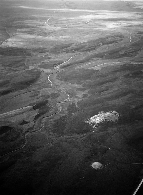 Oblique aerial view centred on the excavation of the long cairn at Camster with the round cairn adjacent, looking to the NW.