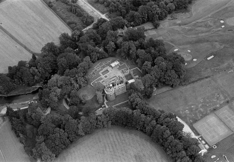 Oblique aerial view centred on the remains of Huntly Castle, looking to the NNE.