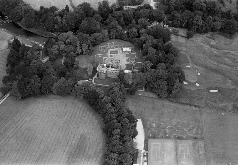 Oblique aerial view centred on the remains of Huntly Castle, looking to the N.