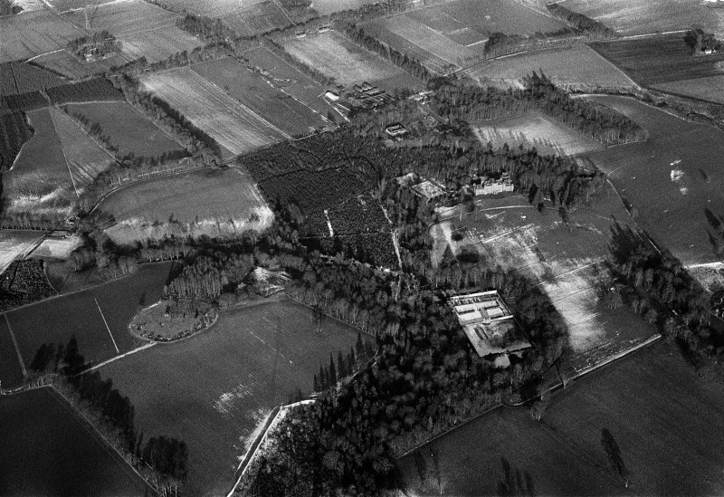Oblique aerial view centred on Fasque House and policies, looking to the NNE.