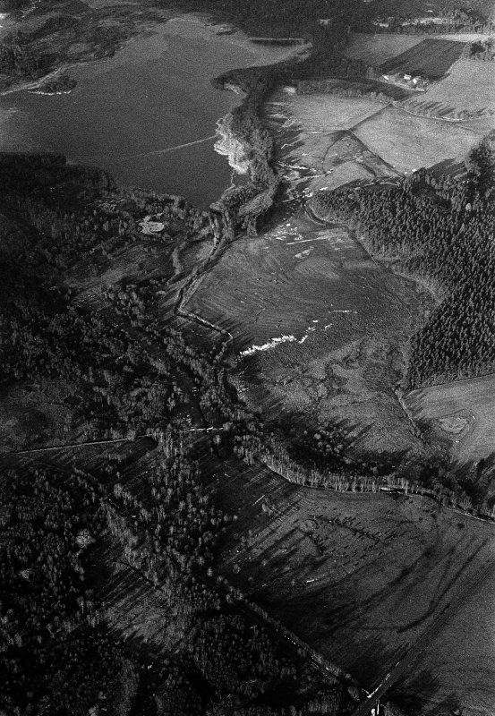 Oblique aerial view centred on the remains of a field system and rig at Monandavan, looking to the NW.