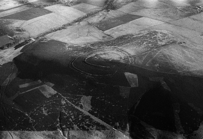 Oblique aerial view centred on the remains of the fort at Brown Caterthun, looking to the ENE.