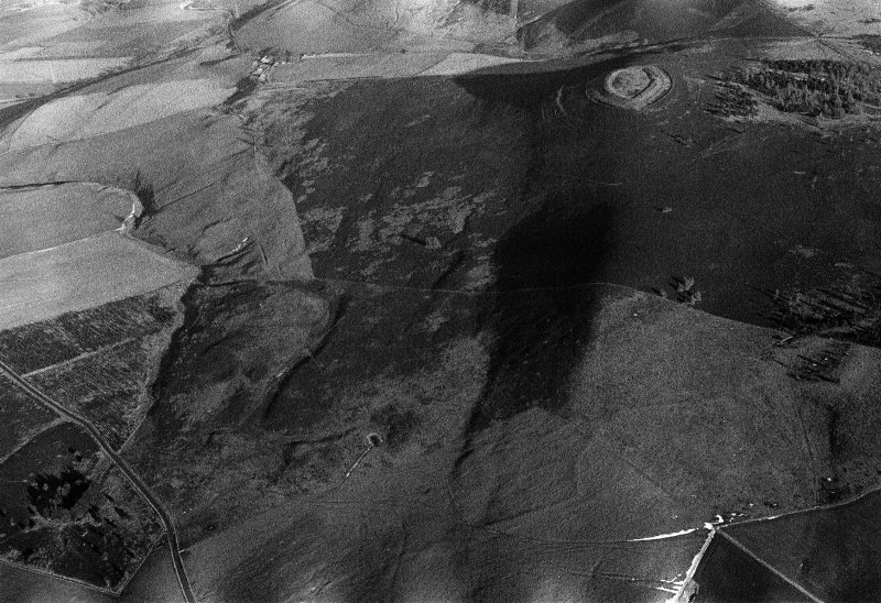 Oblique aerial view centred on the remains of the fort at White Caterthun, looking to the NE.