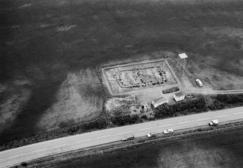 Oblique aerial view centred on the excavation of the timber hall at Balbridie, looking to the N.