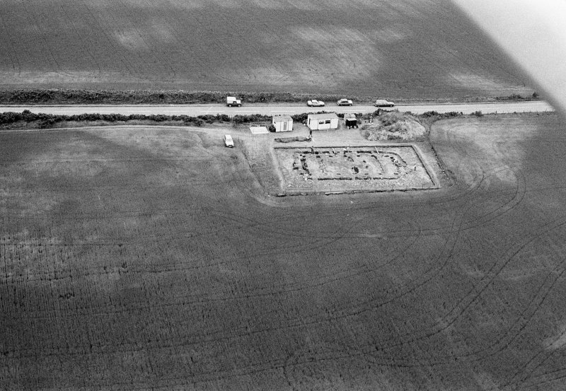 Oblique aerial view centred on the excavation of the timber hall at Balbridie, looking to the SSW.