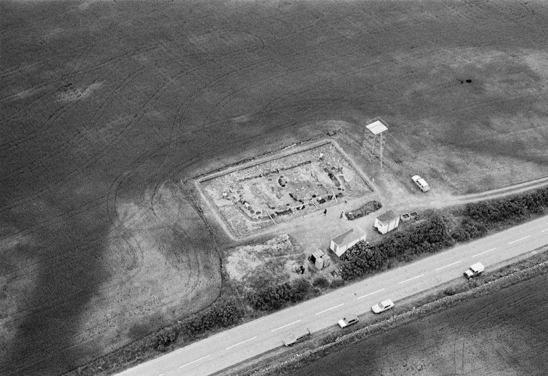Oblique aerial view centred on the excavation of the timber hall at Balbridie, looking to the ENE.